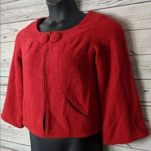 Yoana Baraschi gorgeous red jacket w/ red buttons